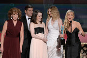 (L-R) Actors Phyllis Logan, Allen Leech, Sophie McShera, Laura Carmichael, and Joanne Froggatt accept the award for Outstanding Performance by an Ensemble in a Drama Series onstage at the 21st Annual Screen Actors Guild Awards at The Shrine Auditorium on January 25, 2015 in Los Angeles, California.