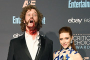 Host T.J. Miller (L) and actress Kate Gorney pose in the press room during The 22nd Annual Critics' Choice Awards at Barker Hangar on December 11, 2016 in Santa Monica, California.