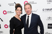 Actor Tim Allen (R) and Jane Hajduk attend the 23rd Annual Elton John AIDS Foundation Academy Awards Viewing Party on February 22, 2015 in Los Angeles, California.