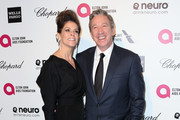 Actors Jane Hajduk (L) and Tim Allen attend the 23rd Annual Elton John AIDS Foundation's Oscar Viewing Party on February 22, 2015 in West Hollywood, California.