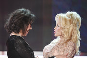 Actor Lily Tomlin (L) accepts the 2016 SAG Life Achievement Award from actor/singer Dolly Parton onstage during the 23rd Annual Screen Actors Guild Awards show at The Shrine Auditorium on January 29, 2017 in Los Angeles, California. / AFP / Robyn BECK