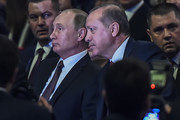 Russian President Vladimir Putin (L) and Turkish President Recep Tayyip Erdogan (R) attend the 23rd World Energy Congress on October 10, 2016 in Istanbul. .Russian President Vladimir Putin arrived in Istanbul on October 10 on his first trip to Turkey following a crisis sparked by the shooting down of a Russian war plane over Syria last November. / AFP / OZAN KOSE
