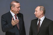 Russian President Vladimir Putin (R) listens to Turkish President Recep Tayyip Erdogan during the 23rd World Energy Congress on October 10, 2016 in Istanbul..Putin visits Turkey on October 10 for talks with counterpart Recep Tayyip Erdogan, pushing forward ambitious joint energy projects as the two sides try to overcome a crisis in ties.. / AFP / OZAN KOSE