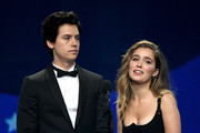 Cole Sprouse (L) and Haley Lu Richardson speak onstage during the 24th annual Critics' Choice Awards at Barker Hangar on January 13, 2019 in Santa Monica, California.