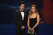 Cole Sprouse (L) and Haley Lu Richardson present the award for Best Acting Ensemble (Film) onstage during the 24th annual Critics' Choice Awards at Barker Hangar on January 13, 2019 in Santa Monica, California.