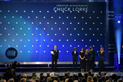 (L-R) Chuck Lorre accepts the Critics? Choice Creative Achievement Award from Kunal Nayyar, Mayim Bialik, Melissa Rauch, Johnny Galecki, and Kaley Cuoco onstage during the 24th annual Critics' Choice Awards at Barker Hangar on January 13, 2019 in Santa Monica, California.