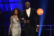 Angela Bassett (L) and Winston Duke present the award for Best Supporting Actor onstage during the 24th annual Critics' Choice Awards at Barker Hangar on January 13, 2019 in Santa Monica, California.