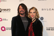 Musician Dave Grohl (L) and Jordyn Blum attends the 24th Annual Elton John AIDS Foundation's Oscar Viewing Party on February 28, 2016 in West Hollywood, California.