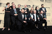 (Standing row) Actors Margaret Colin, Kevin Dunn, Nelson Franklin, Gary Cole, Dan Bakkedahl, Sarah Sutherland, Clea DuVall, and Timothy Simons, (Kneeling row) Paul Scheer, Sam Richardson, Matt Walsh, and Tony Hale, winners of Outstanding Performance by an Ensemble in a Comedy Series for 'Veep,' pose in the press room during the 24th Annual Screen ActorsGuild Awards at The Shrine Auditorium on January 21, 2018 in Los Angeles, California.