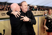 Actors Jonathan Banks (L) and Bob Odenkirk attend the 24th Annual Screen Actors Guild Awards at The Shrine Auditorium on January 21, 2018 in Los Angeles, California. 27522_010