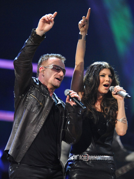 Bono of U2 and Fergie of Black Eyed Peas perform onstage at the 25th Anniversary Rock & Roll Hall of Fame Concert at Madison Square Garden on October 30, 2009 in New York City.