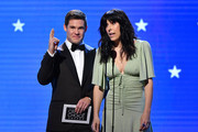 (L-R) Adam DeVine and Edi Patterson speak onstage during the 25th Annual Critics' Choice Awards at Barker Hangar on January 12, 2020 in Santa Monica, California.