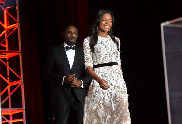Actors Idris Elba (L) and Naomie Harris speak onstage during the 25th annual Palm Springs International Film Festival awards gala at Palm Springs Convention Center on January 4, 2014 in Palm Springs, California.