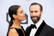 Maria Dolores Dieguez (L) and Joseph Fiennes attend the 25th Annual Screen ActorsGuild Awards at The Shrine Auditorium on January 27, 2019 in Los Angeles, California.