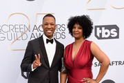 Corey Hawkins (L) and guest attend the 25th Annual Screen ActorsGuild Awards at The Shrine Auditorium on January 27, 2019 in Los Angeles, California. 480645