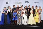 (L-R) Chrissy Metz, Milo Ventimiglia, Parker Bates, Justin Hartley, Faithe Herman, Chris Sullivan, Mackenzie Hancsicsak, Hannah Zeile, Mandy Moore, Lyric Ross, Niles Fitch, Lonnie Chavis, Logan Shroyer, Eris Baker, Jon Huertas, Susan Kelechi Watson, and Melanie Liburd pose in the press room with awards for Outstanding Performance by an Ensemble in a Drama Series in 'This Is Us' during the 25th Annual Screen ActorsGuild Awards at The Shrine Auditorium on January 27, 2019 in Los Angeles, California. 480645