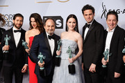 (L-R) Michael Zegen, Marin Hinkle, Kevin Pollak, Rachel Brosnahan, Luke Kirby, and Brian Tarantina, winners of Outstanding Performance by an Ensemble in a Comedy Series for 'The Marvelous Mrs. Maisel,' attend the 25th Annual Screen ActorsGuild Awards at The Shrine Auditorium on January 27, 2019 in Los Angeles, California.