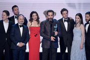 (L-R) Brian Tarantina, Zachary Levi, Kevin Pollak, Marin Hinkle, Tony Shalhoub, Luke Kirby, Rachel Brosnahan, and Michael Zegen accept the Outstanding Performance by an Ensemble in a Comedy Series awrad for 'The Marvelous Mrs Maisel' onstage during the 25th Annual Screen ActorsGuild Awards at The Shrine Auditorium on January 27, 2019 in Los Angeles, California.