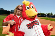 Recording artist Bucky Covington and Nashville Sounds mascot Booster attend the 26th Annual City of Hope Celebrity Softball Game at First Tennessee Park on June 7, 2016 in Nashville, Tennessee.