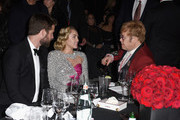 (L-R) Liam Hemsworth, Miley Cyrus and Sir Elton John attend the 26th annual Elton John AIDS Foundation Academy Awards Viewing Party with cocktails by Clase Azul Tequila at The City of West Hollywood Park on March 4, 2018 in West Hollywood, California.