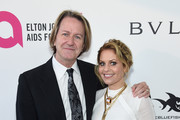 Jim Head (L) and Candace Cameron Bure  attends the 26th annual Elton John AIDS Foundation Academy Awards Viewing Party sponsored by Bulgari, celebrating EJAF and the 90th Academy Awards at The City of West Hollywood Park on March 4, 2018 in West Hollywood, California.