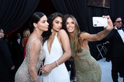 (L-R) Adriana Lima, Shanina Shaik,  Heidi Klum  attends the 26th annual Elton John AIDS Foundation Academy Awards Viewing Party sponsored by Bulgari, celebrating EJAF and the 90th Academy Awards at The City of West Hollywood Park on March 4, 2018 in West Hollywood, California.