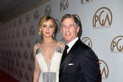 Actress Jennifer Lawrence and Lionsgate CEO Jon Feltheimer attend the 26th Annual Producers Guild Of America Awards at the Hyatt Regency Century Plaza on January 24, 2015 in Los Angeles, California.
