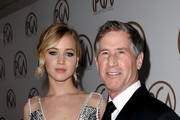 Actress Jennifer Lawrence (L) and Jon Feltheimer, CEO, Lionsgate Entertainment arrive at the 26th Annual Producers Guild of America Awards at the Hyatt Regency Century Plaza Hotel on January 24, 2015 in Los Angeles, California.