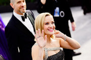 Jim Toth (L) and Reese Witherspoon attend the 26th annual Screen Actors Guild Awards at The Shrine Auditorium on January 19, 2020 in Los Angeles, California.