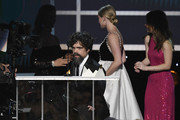 Peter Dinklage accepts Outstanding Performance by a Male Actor in a Drama Series for 'Game of Thrones' from Kaitlyn Dever and Lili Reinhart onstage during the 26th Annual Screen Actors Guild Awards at The Shrine Auditorium on January 19, 2020 in Los Angeles, California. 721359