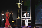 Sam Rockwell (R) accepts Outstanding Performance by a Male Actor in a Television Movie or Miniseries for 'Fosse/Verdon' from Lupita Nyong'o and Danai Gurira onstage during the 26th Annual Screen ActorsGuild Awards at The Shrine Auditorium on January 19, 2020 in Los Angeles, California. 721359