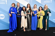 """The Marvelous Mrs. Maisel"" cast (L-R) Caroline Aaron, Jane Lynch, Stephanie Hsu, Marin Hinkle, Rachel Brosnahan, Alex Borstein and Matilda Szydagis pose in the press room with the trophy for Outstanding Performance by an Ensemble in a Comedy Series during the 26th Annual Screen Actors Guild Awards at The Shrine Auditorium on January 19, 2020 in Los Angeles, California. 721430"