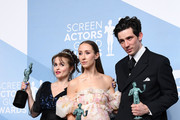 (L-R) Helena Bonham Carter, Erin Doherty, and Josh O'Connor, winners of Outstanding Performance by an Ensemble in a Drama Series for 'The Crown', pose in the press room during the 26th Annual Screen Actors Guild Awards at The Shrine Auditorium on January 19, 2020 in Los Angeles, California.