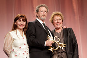 Director Robert Guediguian (C) is awarded 'Swann d'Or' Best Director by his wife/actress Ariane Ascaride (L) and Danielle Gain (R) during 26th Cabourg Romantic Film Festival on June 16, 2012 in Cabourg, France.
