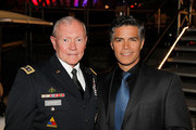 General Martin E. Dempsey, Chairman, Joint Chiefs of Staff, and actor Esai Morales pose for a photo at the 26th National Memorial Day Concert on May 24, 2015 in Washington, DC.