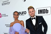 (L-R) Leona Lewis and Dennis Jauch attend the 27th annual Elton John AIDS Foundation Academy Awards Viewing Party sponsored by IMDb and Neuro Drinks celebrating EJAF and the 91st Academy Awards on February 24, 2019 in West Hollywood, California.