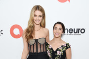 Kate Bock and  Aly Raisman attend the 28th Annual Elton John AIDS Foundation Academy Awards Viewing Party sponsored by IMDb, Neuro Drinks and Walmart on February 09, 2020 in West Hollywood, California.