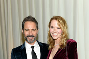 Eric McCormack and Janet Holden attend the 28th Annual Elton John AIDS Foundation Academy Awards Viewing Party sponsored by IMDb, Neuro Drinks and Walmart on February 09, 2020 in West Hollywood, California.