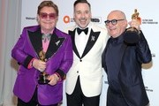 (L-R) Sir Elton John, David Furnish and Bernie Taupin attend the 28th Annual Elton John AIDS Foundation Academy Awards Viewing Party sponsored by IMDb, Neuro Drinks and Walmart on February 09, 2020 in West Hollywood, California.