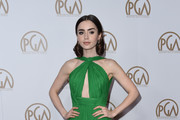 Actress Lily Collins arrives on the red carpet for the 2017 Producers Guild Awards at the Beverly Hilton in Beverly Hills, California on January 28, 2017. / AFP / Chris Delmas