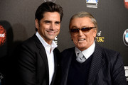 Actor John Stamos and producer Robert Evans arrive at the 2nd Annual Rebels With A Cause Gala at Paramount Studios on March 20, 2014 in Hollywood, California.