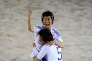 Takasuke Goto of Japan celebrates with team mate Teruki Tabata after scoring a goal in the Men's Beach Soccer Quarterfinal match between Japan and United Arab Emirates at Al-Musannah Sports City during day seven of the 2nd Asian Beach Games Muscat 2010 on December 14, 2010 in Muscat, Oman.