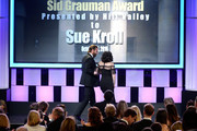 Honoree Sue Kroll (R) accepts the Sid Grauman Award from actor Bradley Cooper onstage at the 30th Annual American Cinematheque Awards Gala at The Beverly Hilton Hotel on October 14, 2016 in Beverly Hills, California.