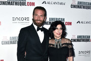 Actor Bradley Cooper (L) and Warner Bros. Pictures President of Worldwide Marketing and Distribution Sue Kroll attend the 30th Annual American Cinematheque Awards Gala at The Beverly Hilton Hotel on October 14, 2016 in Beverly Hills, California.