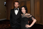 Actor Bradley Cooper (L) and honoree Sue Kroll attend the 30th Annual American Cinematheque Awards Gala at The Beverly Hilton Hotel on October 14, 2016 in Beverly Hills, California.