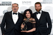 (L-R) Alcantara CEO Andrea Boragno, Sid Grauman Award recipient Sue Kroll, and actor Bradley Cooper attend the 30th Annual American Cinematheque Awards Gala at The Beverly Hilton Hotel on October 14, 2016 in Beverly Hills, California.