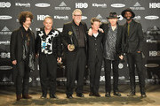 (L-R) Doyle Bramhall II, Jimmie Vaughan, Reese Wynans, Chris Layton, Tommy Shannon and Gary Clark Jr. attend the 30th Annual Rock And Roll Hall Of Fame Induction Ceremony at Public Hall on April 18, 2015 in Cleveland, Ohio.