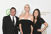 (L-R) A.J. Dix, Charlize Theron, and Beth Kono attend the 31st Annual Producers Guild Awards at Hollywood Palladium on January 18, 2020 in Los Angeles, California.