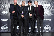 (L-R) Ian Gillan, Ian Paice, and Roger Glover of Deep Purple pose with Lars Ulrich of Metallica on stage in the press room at the 31st Annual Rock And Roll Hall Of Fame Induction Ceremony at Barclays Center of Brooklyn on April 8, 2016 in New York City.