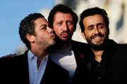 French actor Manu Payet, Monsieur Poulpe and Jonathan Cohen pose on the red carpet on June 16, 2017 during the Cabourg Romantic Film Festival in Cabourg, northwestern France. / AFP PHOTO / CHARLY TRIBALLEAU
